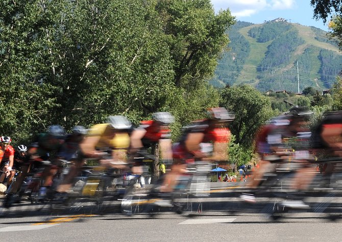 The field for the men's pro division in the Steamboat Springs Stage Race flies around a corner in downtown Steamboat Springs on Monday, bringing to a close  the four-day event and the large competitive summer cycling calendar in Steamboat. The third-year stage race proved popular with competitors, but organizers questioned whether it'd return in 2012.