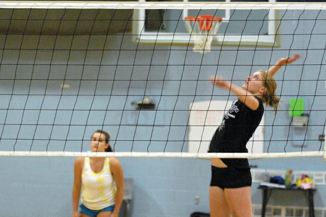 Kelsey Pomeroy, a Moffat County High School junior, goes up for the ball during practice Aug. 24 at MCHS. The MCHS varsity volleyball team went 2-2 during the Regis Jesuit Tournament on Friday and Saturday in Aurora.