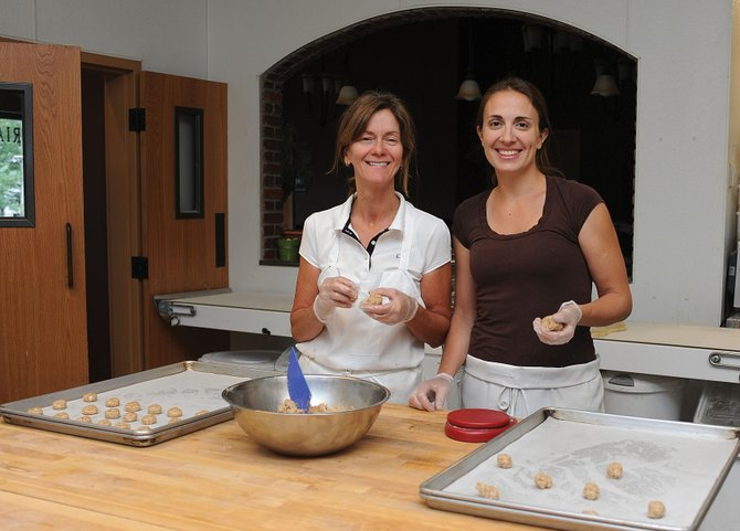 Mary Ann Gunn and Lisa Ciraldo bake cookies at the Chocolate Soup location on Mount Werner Cirlce. Chocolate Soup is now selling some products wholesale in Whole Foods Market stores.