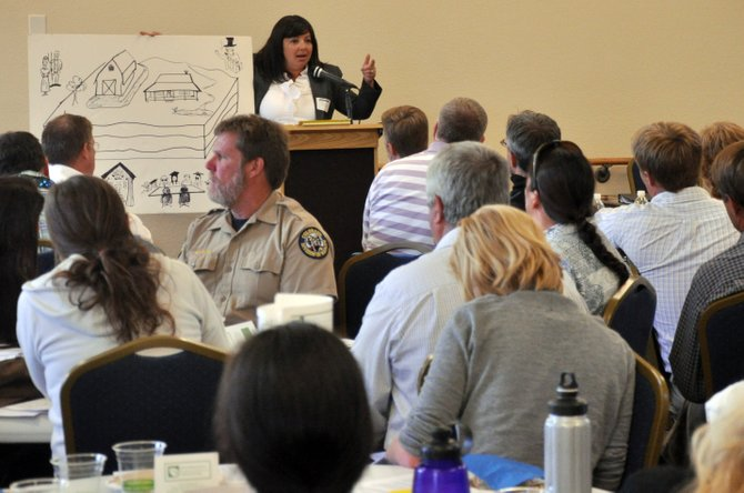 Steamboat Springs attorney Jessica Ryan uses a drawing Wednesday night to help explain the contract-negotiation process for leases involving oil and gas exploration during the Northwest Colorado Oil and Gas Symposium in Hayden.