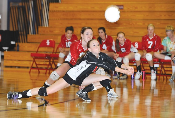 Steamboat Springs defensive specialist Kailee Duryea digs a ball in the third game against Vail Mountain School on Wednesday afternoon at Steamboat Springs High School. The Sailors won in straight sets.