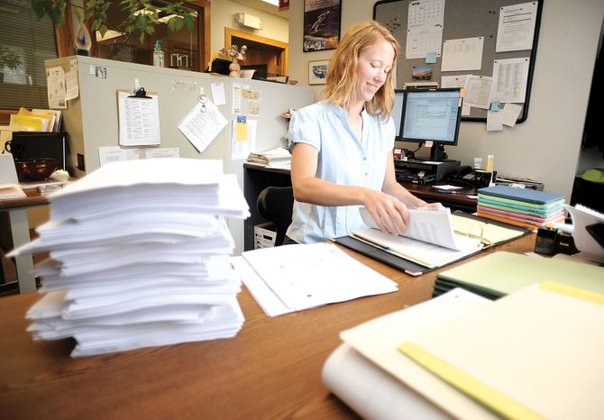 Anja Tribble, staff assistant for the city of Steamboat Springs, typically recycles stacks of paper used to print Steamboat Springs City Council agendas from the most recent meeting. The city bought iPads for council members in an effort to cut down on waste and make the process of distributing agendas more efficient.