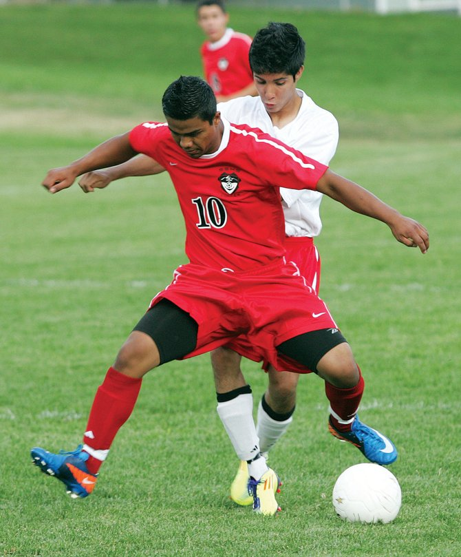 Steamboat Springs senior Enrique Lopez battles for possession during Thursday's game at Glenwood Springs. The Sailors won, 4-1.