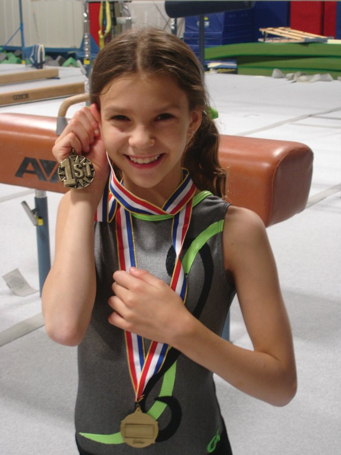 Emma Cooke won the all-around competition in the ages 7 to 10 division Sept. 3 at the Labor Day weekend meet at Excel Gymnastics.