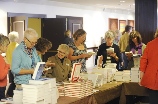 A few of the 500 Literary Sojourn attendees browse books during the 19th annual event Saturday at Sheraton Steamboat Resort.