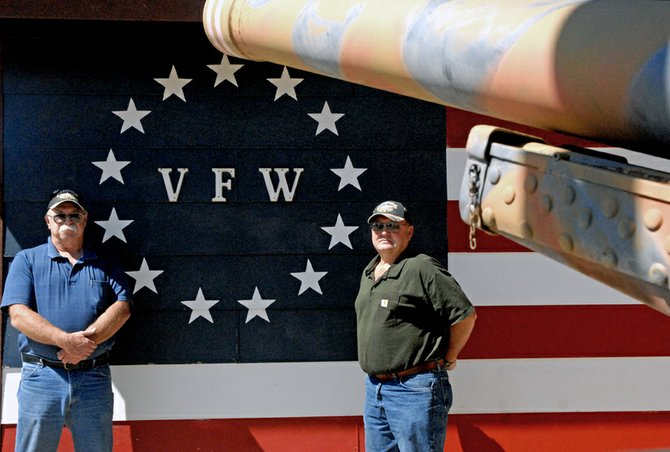 Mark Wick, left, commander of the Veterans of Foreign Wars Post 4265, and VFW Quartermaster Larry Neu stand outside the VFW post in Craig. They said they're relieved veterans coming home from overseas conflicts today are given a warm welcome rather than the aggressive reaction they and other Vietnam veterans were subjected to.
