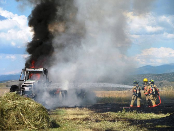 A tractor and hay field caught fire Saturday in South Routt.