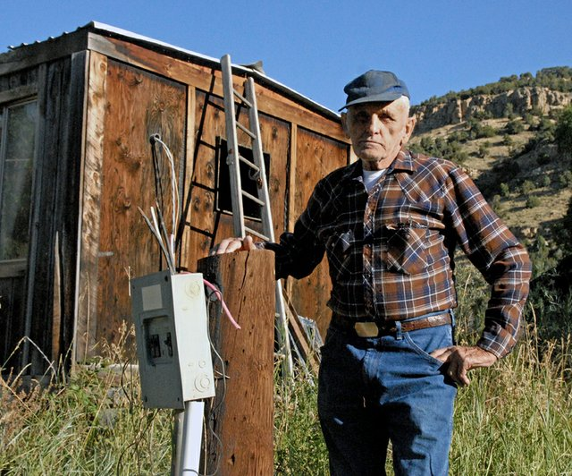 Ray Wagner stands next to his chopped power pole and disconnected electrical box. Wagner says Yampa Valley Electric Association cut his service without notice in early August.