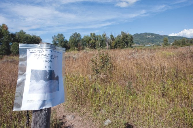 A sign stands in a field near Whistler Park, where some residents would like to see a new bike park constructed. While the proposed park has supporters, it also has met with resistance from nearby residents.