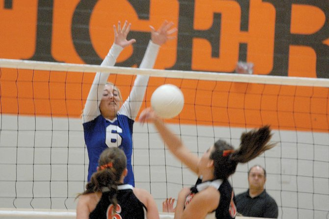 Makayla Camilletti, a Moffat County High School junior, knocks the volleyball back to the opponent's side Tuesday at Hayden High School. MCHS struggled in the first set, but rebounded to beat Hayden, 3-1.
