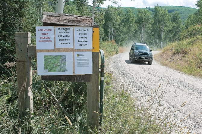 Signs along the side of Buffalo Pass Road just past the Dry Lake Campground parking area warn motorists that the route will be closed for six to eight weeks beginning Monday.