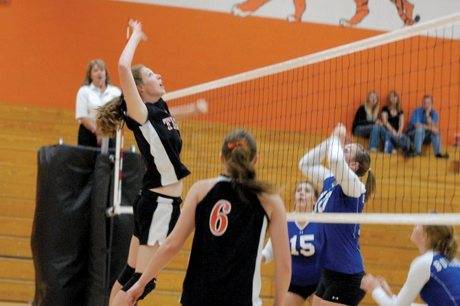 Hayden High School senior Aubree Haskins prepares to spike the ball against Moffat County High School on Tuesday in Hayden. The Tigers won the first set, 26-24, but couldnt keep up with the 4A Bulldogs, falling 3-1.