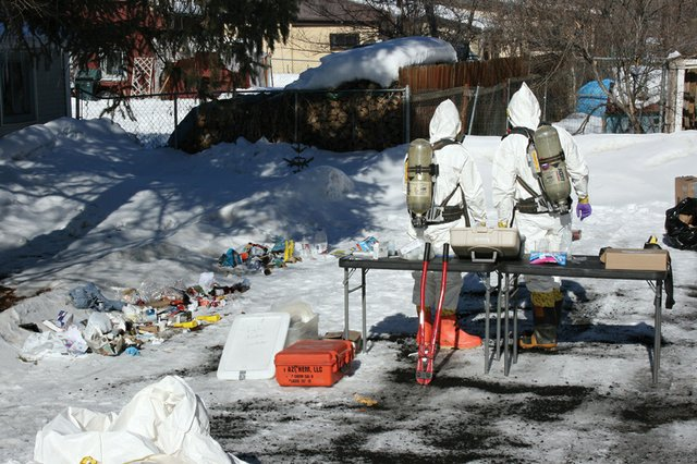Hazardous materials personnel employed by the Drug Enforcement Administration remove toxic materials following a meth lab bust in January in Hayden. The All Crimes Enforcement Team estimates the four suspects apprehended in the raid were profiting $3,200 to $4,800 per week.