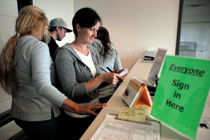 Michele Smith, of Craig, casts her vote in the student government election Wednesday morning at Colorado Northwestern Community College's Craig campus. Smith, originally of Arvada, is a first-year nursing student at the college.
