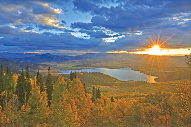 Celebrated Steamboat Springs nature photographer Rod Hanna used software called Photomatix Pro to blend five exposures of the same scene to achieve this image of a late autumn sunset behind Lake Catamount.