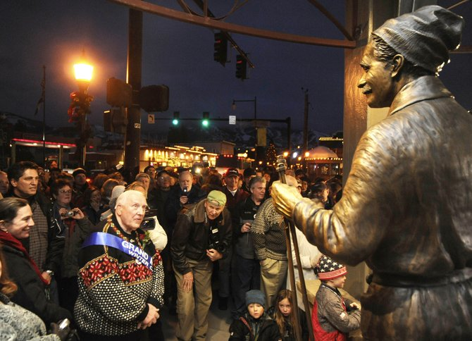 Leif Hovelsen admires the statue of his father Carl Howelsen when it was unveiled in February 2009 at the Howelsen Place building at Seventh Street and Lincoln Avenue.