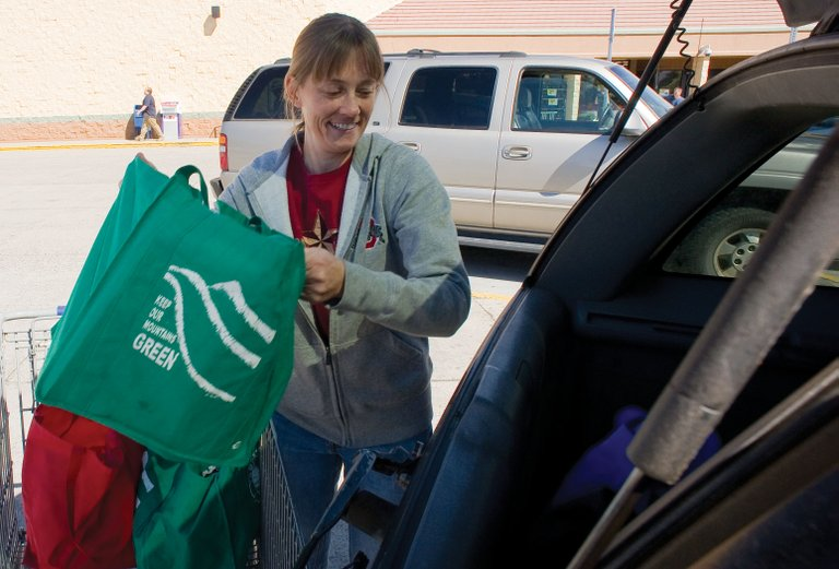 Jennifer Campbell loads reusable grocery sacks into the back of her car Monday after shopping at City Market. Steamboat Springs City Council will hear a presentation Tuesday night about bag fee ordinances in other Colorado communities. The council is considering rules that could affect shoppers who use plastic instead of reusable alternatives.
