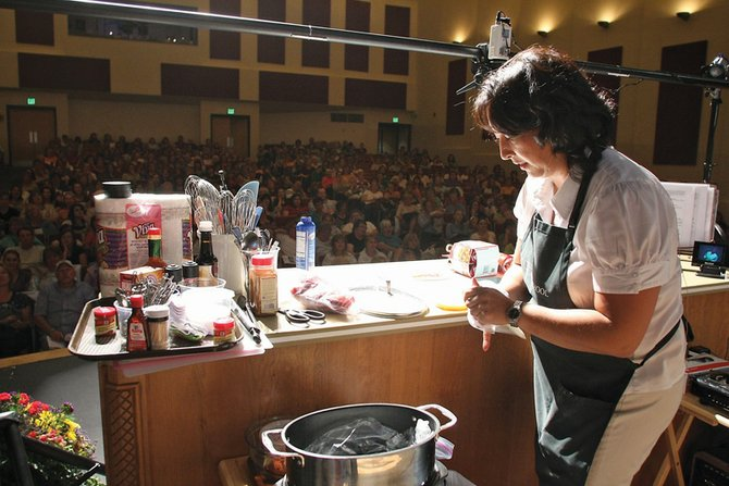 Danielle Edmonds, territory manager/culinary specialist with the Taste of Home Cooking School, prepares a dish during the show in Craig in 2009. The event is scheduled for 7 p.m. Oct. 3 at the Moffat County High School auditorium.