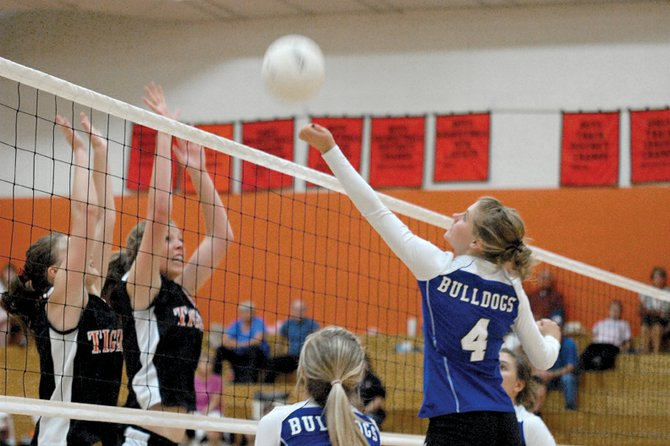 The Moffat County High School varsity volleyball team struggled in its first two Western Slope League matches, losing in three straight sets Friday at Palisade High School and Saturday at Delta High School. Above, MCHS junior Kelsey Pomeroy hits the ball over the net in a match earlier this season.