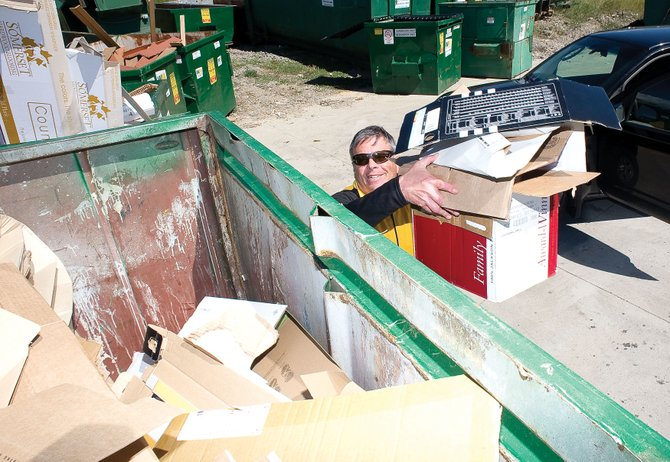 Jerry Mason drops off cardboard Monday afternoon at a recycling unit at Waste Management. Yampa Valley Recycles and the Yampa Valley Sustainability Council presented funding requests to the Routt County commissioners for recycling programs.