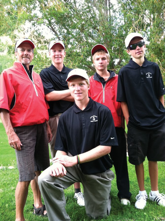 The Steamboat Springs High School golf team preps for the regional tournament Tuesday in Rifle. Back row, from left, are coach Steve Dodson, Erik Sobeck, Brandon Martin and Andrew Firestone. Kneeling is Sam Samlowski.