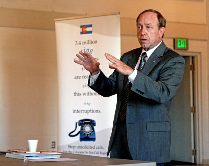 Colorado Attorney General John Suthers discusses fraud Monday with 30 local senior citizens at The Center of Craig, 601 Yampa Ave. Suthers said no one is immune to the activities of scammers and con men. He fell victim to identity theft in June 2006.