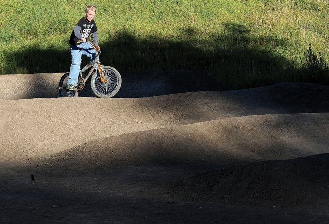 Nine-year-old Dimitri Bice rides his bike Friday on Oak Creek's pump track. The track was built during Labor Day weekend using grant money as a part of the town's new recreation plan.