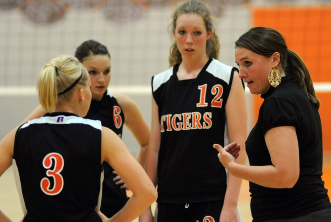 Hayden coach Holli Palmer talks with her team late in Saturday's three-game loss to Rangely.