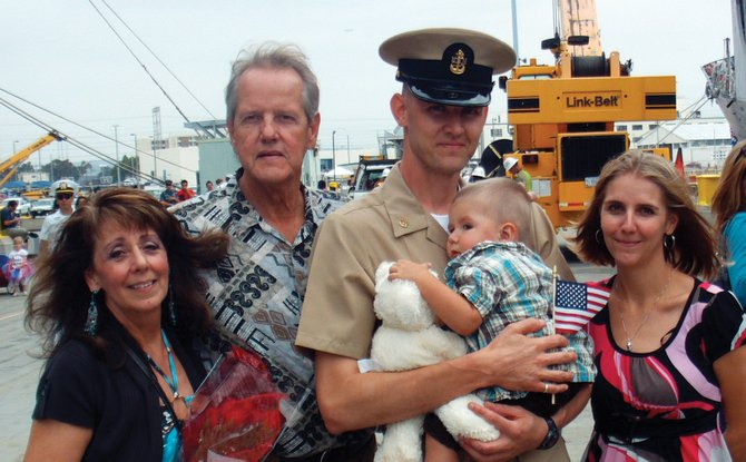Andy Kitzman, middle, is a hull maintenance technician chief in the U.S. Navy. He is shown standing with his family Sept. 16, the day he returned from a six-month deployment, in San Diego. His family includes, from left, stepmother Irene Kitzman, father Brian Kitzman, 19-month-old son Tanner Bryan Kitzman, and wife Alanna.