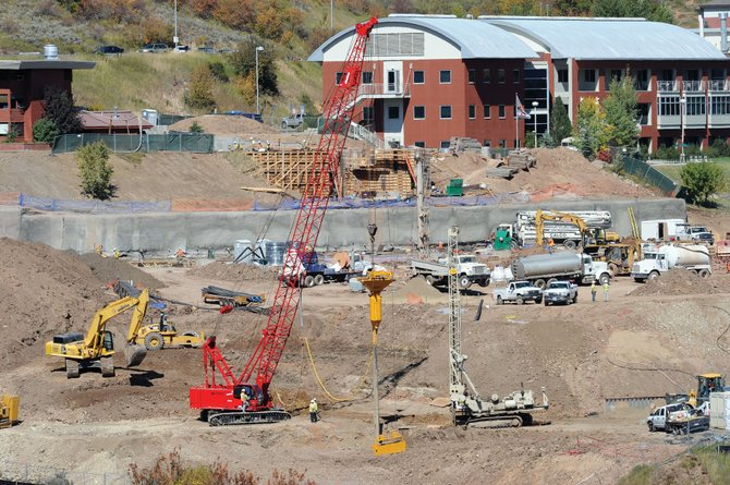 Construction crews continue to work on a new 60,000-square-foot building Monday morning. The building will become the centerpiece of the Colorado Mountain College campus when it is completed in July.