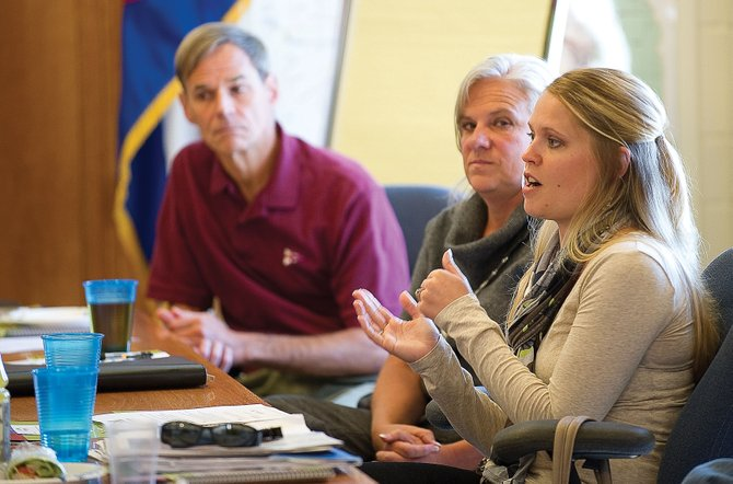Steamboat Springs School Board candidate Rebecca Williams speaks at a forum hosted by First Impressions of Routt County on Wednesday afternoon. She is running against Sandra Sharp, middle. Wayne Lemley, left, is running unopposed for a seat on the School Board.