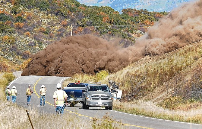 A wall of dirt and rock comes tumbling down a hillside on Colorado Highway 131 on Wednesday afternoon between Steamboat Springs and Oak Creek. Construction crews working for the Colorado Department of Transportation are working on widening and improving a three-mile stretch of highway in Oak Creek Canyon.