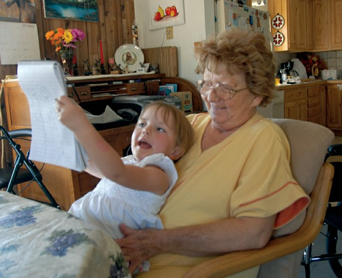 Carol Allen spends time with her great-granddaughter, Alyvia Cox, 4, at her home north of Craig. Allen was diagnosed with breast cancer in 2005 when it was detected during a routine mammogram. She credits the screening with saving her life. October is Breast Cancer Awareness Month, and The Memorial Hospital in Craig is offering discounted mammograms that could help more people like Allen from falling to the disease.