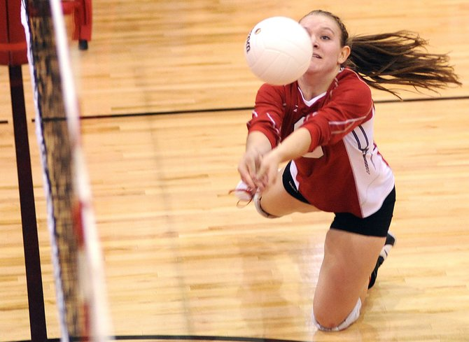 Steamboat's Nikki Fry dives for a dig Thursday as the Sailors swept the Moffat County Bulldogs in three games.