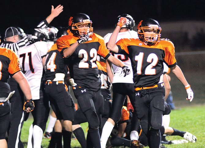 Hayden senior Chad Terry, 12, pumps his fist after the Tigers defense came up with a key goal-line stand late in Friday nights 13-6 win against Paonia.