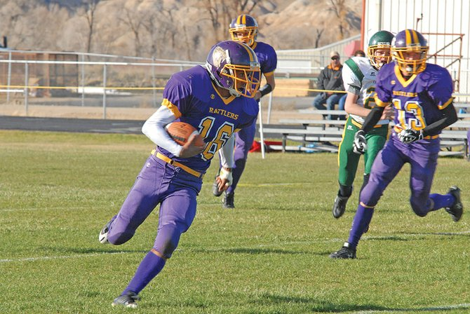 The Little Snake River Valley School six-man varsity football team had no trouble in the 2010 state championship rematch against Hanna-Elk Mountain High School on Friday, shutting out Hanna in a 52-0 victory. Manuel Quinteros, pictured above, helped lead the offense with 93 rushing yards.
