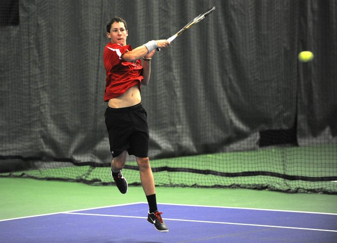 Steamboat Springs High School senior Jamey Swiggart hits a shot during his match Saturday at the Tennis Center at Steamboat Springs.