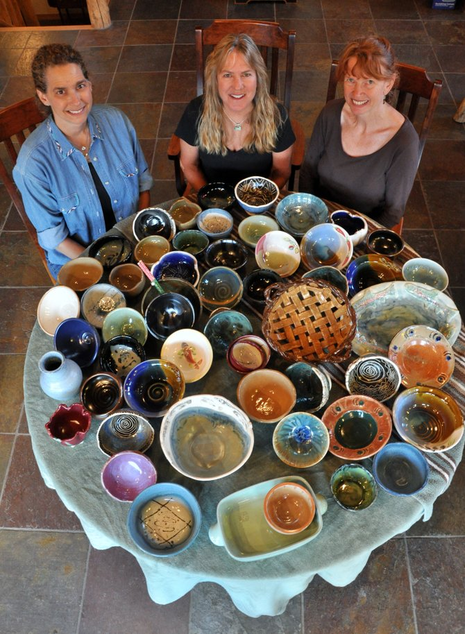 Steamboat Clay Artisans members, from left, Sue Binsfeld, Kathy Thayer, and Jody Elston sit with a variety of clay bowls that will be used at the 10th annual Soup Supper. The supper this year will benefit the Routt County Council on Aging.