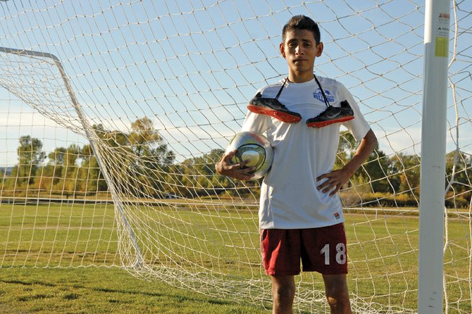 Johnny Landa, a Moffat County High School senior, stands on the soccer fields at Loudy-Simpson Park. Landa is a two-sport athlete this fall, competing on the MCHS boys varsity soccer team and on the MCHS varsity cross-country team.