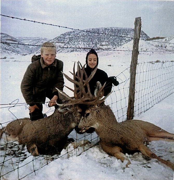 Ted Myers, left, poses with an unknown friend on his family's ranch near Hamilton. Myers found the entangled bucks while rabbit hunting Dec. 11, 1966.