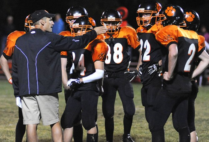 Hayden High School football coach Shawn Baumgartner directs his team late in Friday's 13-6 victory against Paonia. The win boosted the Tigers to near the front of the Class 1A Western Slope League standings, but no matter how the season turns out, Hayden's not likely to stick with 11-man football. A shrinking school enrollment combined with a growth in school size at the state's 1A classification, quickly could render the Tigers uncompetitive in the division. They'll have the option of joining the 8-man ranks for play next year, and school officials are leaning toward taking it.