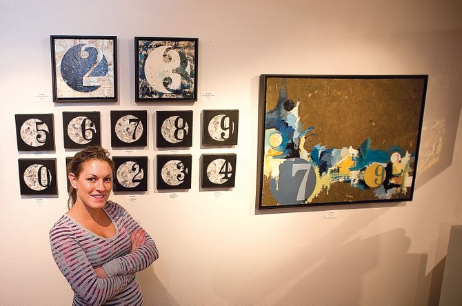 Artist Missy Borden stands in front of her work, which is on display at the Steamboat Springs Center for Visual Arts in downtown Steamboat. An opening reception will be held from 5 to 8 p.m. today during First Friday Artwalk.