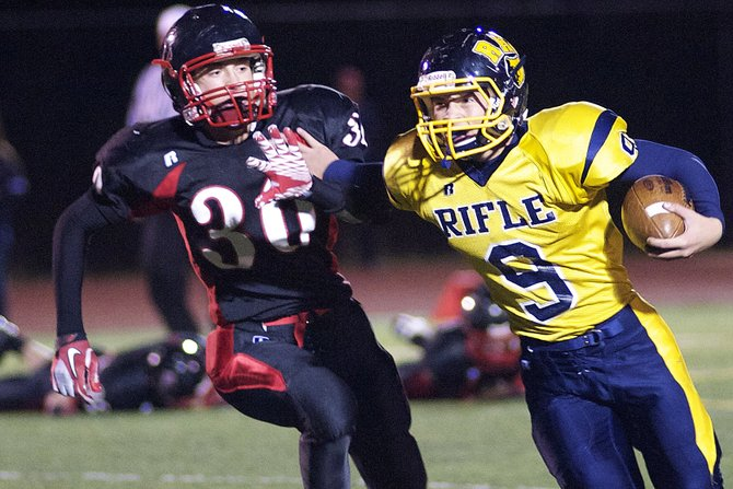 Rifle's Brandon Kittle holds off Steamboat Springs defender Skyler Kauf on Friday night. Kittle and the Bears racked up huge rushing totals — nearly 600 as a team — to knock off Steamboat Springs on homecoming night, 47-12.