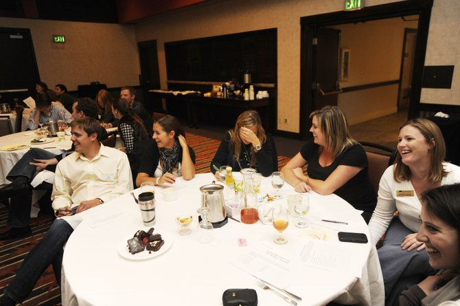 Steamboat Springs Young Professionals Network members, from left, Glen Traylor, Stephany Swinford, Ashley Reed, Sarah Leonard, Marion Taylor and Morgan McDougald listen to Saturday's keynote speaker during the inaugural Rocky Mountain Young Professionals Summit at the Sheraton Steamboat Resort.