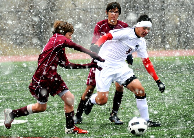 Steamboat's Michael Wong pushes the ball up the field Saturday as the Sailors tallied a 5-0 win against Palisade.