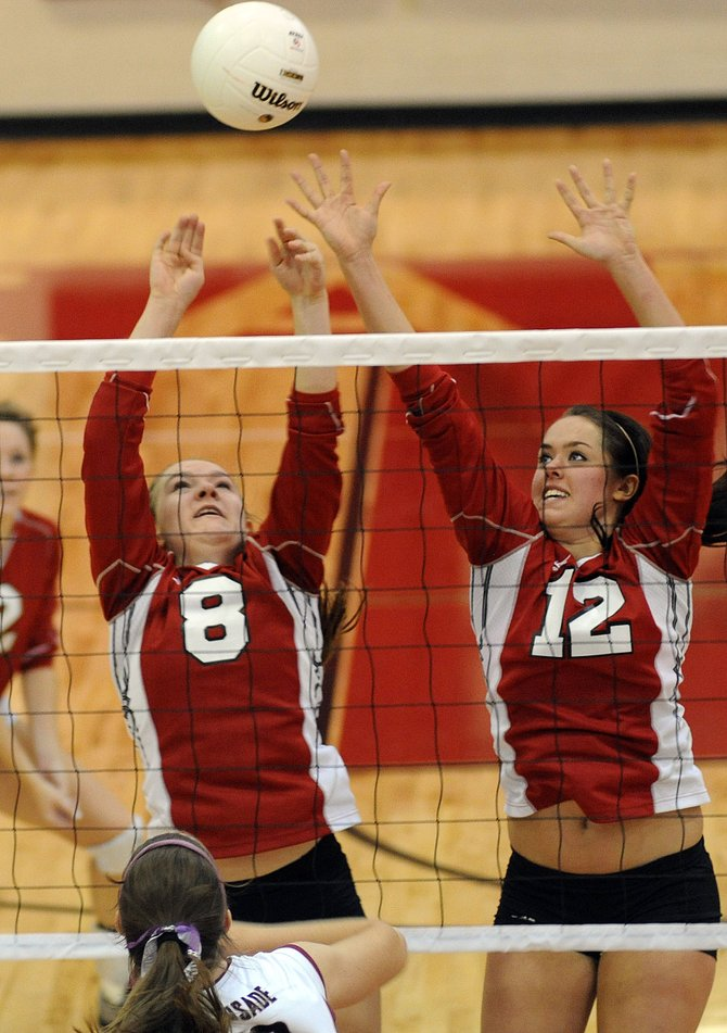 Steamboat's Nikki Fry, left, and Amy Brodie reach for a block Saturday as the Sailors battled Palisade. Steamboat lost the match, falling in three games.