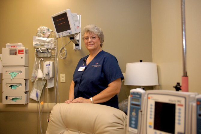 Marie Kettle stands Thursday in the infusion clinic at The Memorial Hospital in Craig. Kettle, who has worked at TMH for nearly 36 years, is scheduled to become the hospital's full-time infusion nurse later this month.