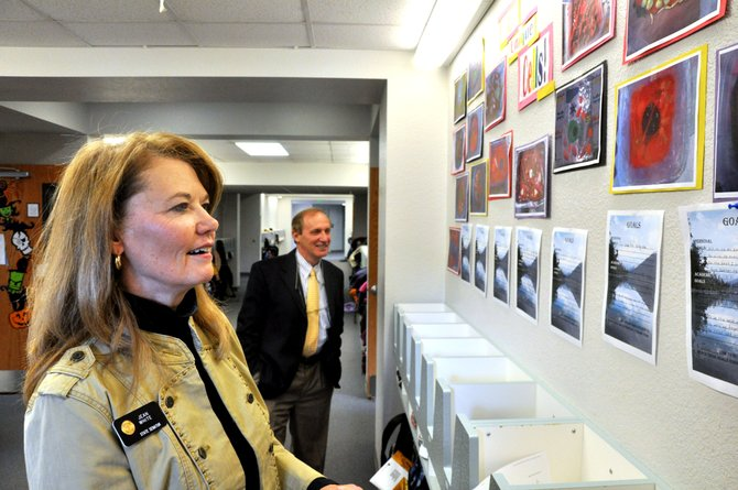 Colorado Sen. Jean White, looks at the artwork of South Routt Elementary School students Tuesday in Yampa. White is touring all of the schools she represents to learn about new programs they are introducing and to see how their classrooms have been affected by recent budget cuts.