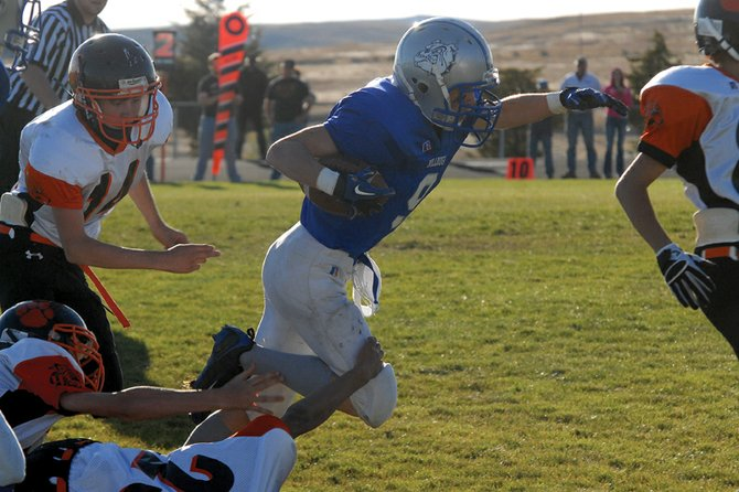 Thayne Riley, a Moffat County High School freshman, breaks free from a Hayden High School defender on his way to a rushing touchdown Monday at MCHS. Riley had two touchdowns on the ground as the Bulldogs shut out Hayden, 30-0.