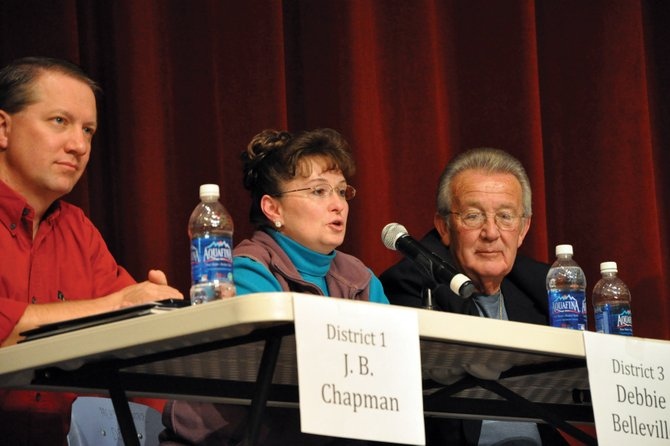 Debbie Belleville, center, a candidate for the Moffat County School Board District 3 position, speaks at a candidate forum Tuesday at the Moffat County High School auditorium as fellow candidate J.B. Chapman, left, and incumbent Tony St. John look on. School board hopefuls answered questions about a variety of topics ranging from school finance to student achievement.